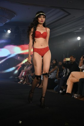 Stunning model walking in Ramp wearing Red Lingerie for Trump Fashion Week 2017