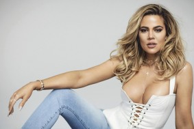khloe in a white corset top