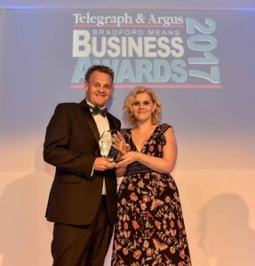 Janine Dutton receiving her Business Woman of the Year award