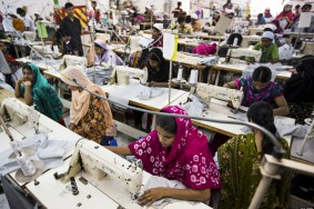 Workers sew garments on the production line of the Protik Apparels garment factory in Dhaka, Bangladesh, on Monday, April 29, 2013. Bangladesh authorities said they were accelerating rescue efforts at the factory complex that collapsed last week as hopes fade for more survivors after the nation's biggest industrial disaster. The government has decided to constitute a panel to identify garment factories in the country at risk of collapse, cabinet secretary Hossain Bhuiyan told reporters on April 29. Photographer: Jeff Holt/Bloomberg via Getty Images