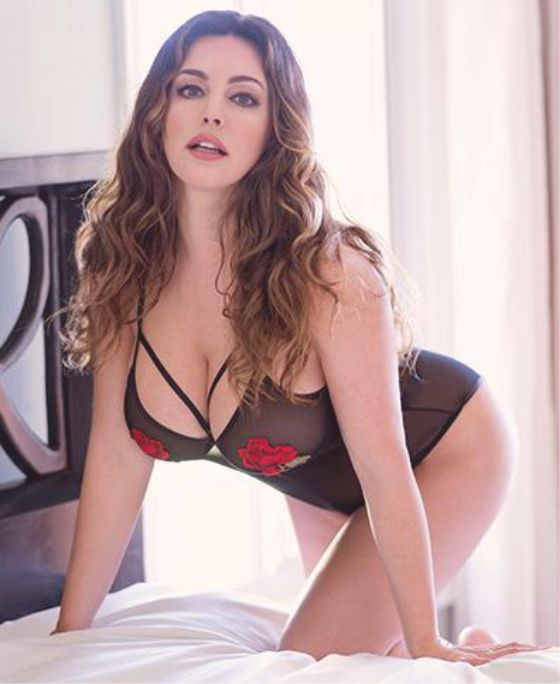 Model Kelly Brook pulses racing in lacy black lingerie