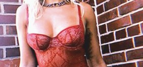 Gorgeous Rita Ora smoulders in a red bustier - 1