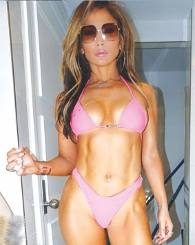 Jennifer Lopez oozes sex appeal in a neon pink bra & panties (two-piece)