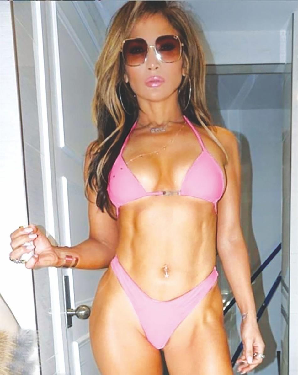 Jennifer Lopez oozes sex appeal in a neon pink bra & panties (two-piece)
