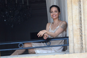 EXCLUSIVE: PREMIUM EXCLUSIVE    American Actress Angelina Jolie is seen outside on a balcony while doing a photoshoot for 'Guerlain' in Paris, France, on July 8, 2019.    Pictured: Angelina Jolie  Ref: SPL5102736 080719 EXCLUSIVE  Picture by: AbacaPress / SplashNews.com    Splash News and Pictures  Los Angeles: 310-821-2666  New York: 212-619-2666  London: 0207 644 7656  Milan: 02 4399 8577  photodesk@splashnews.com    Australia Rights, United Kingdom Rights, United States of America Rights