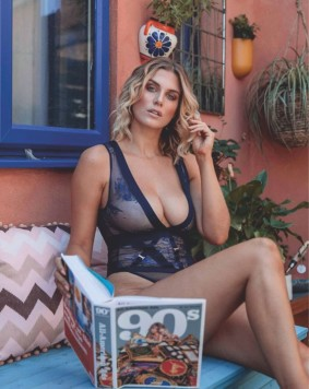 Ashley James looks ethereal in a black sheer lingerie