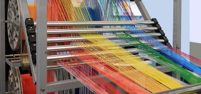 bigstock-Multi-colored-Yarns-In-The-Tex-310792042