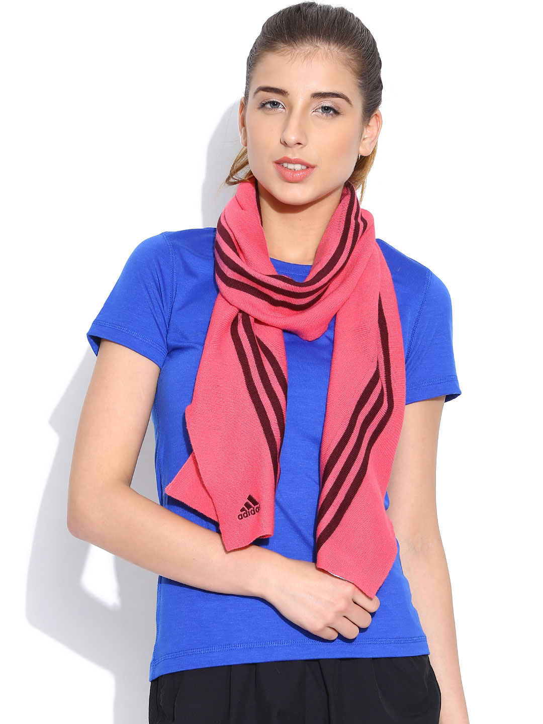 A Model in Blue tshirt and adidas pink Ess Striped Stole