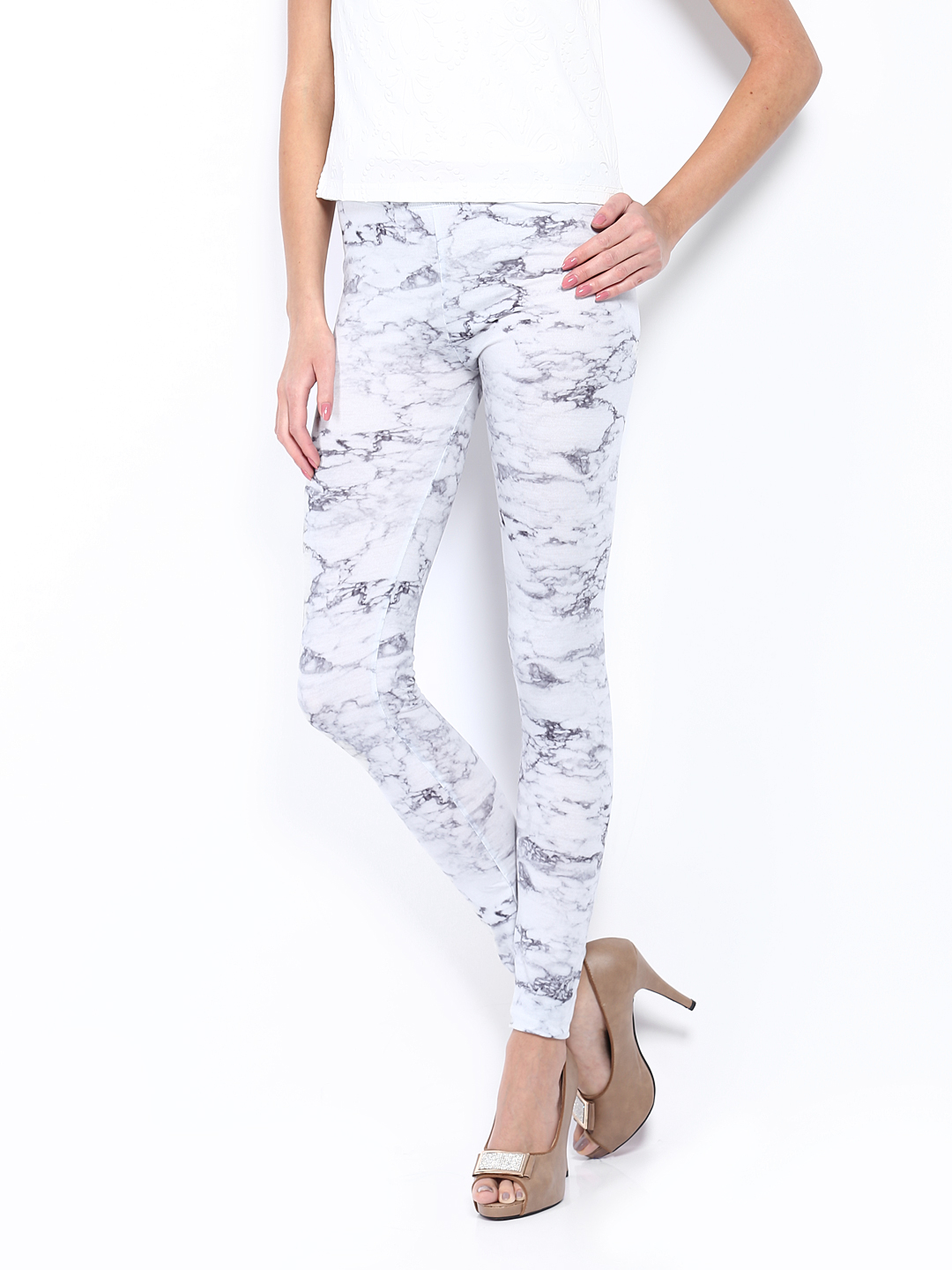 A Model wearing White Top and Vero Moda grey Printed Poly Stretch Leggings