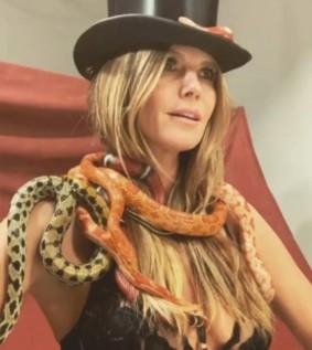 Heidi Klum models in lingerie with snakes around her neck