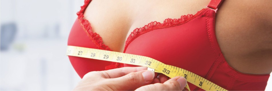 measuring size of women breast with tape